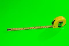 Tape measure on green background. Perfect to put on any surface Royalty Free Stock Photos