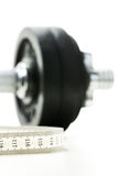 Tape measure and gym weight Stock Image