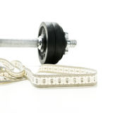 Tape measure and gym weight Stock Images