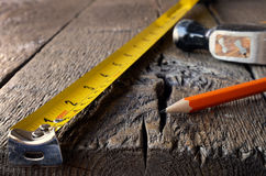 Tape Measure and Hammer Royalty Free Stock Images