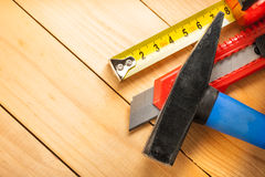 Tape measure, hammer and knife Royalty Free Stock Photo