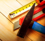 Tape measure, hammer and knife Royalty Free Stock Images