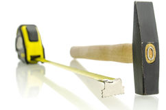 Tape measure and hammer Royalty Free Stock Photography