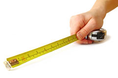 Tape-measure in hand Stock Photos