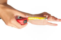 Tape measure in hands Stock Photo