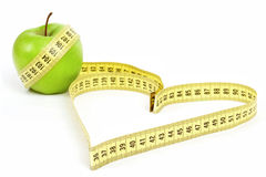 Tape Measure Heart Shape And Green Apple Stock Photos