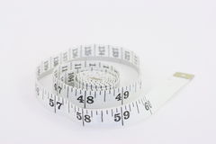 Tape measure inches. Shallow depth of field close up of a tape measure showing inches stock images