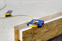Tape measure on an insulating wall Royalty Free Stock Photography