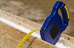 Tape measure on an insulating wall Stock Image