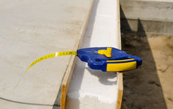 Tape measure on an insulating wall Royalty Free Stock Photo