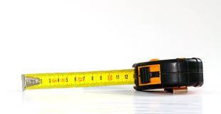 Tape-measure. Tape measure isolated on a white background royalty free stock images