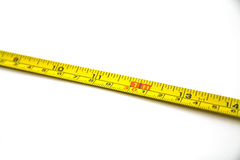 Tape measure. An isolated tape-measure on white background Stock Images