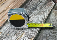 Tape measure isolated on wood Stock Photo