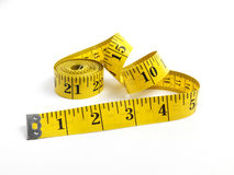 Tape Measure. Isolated yellow tape measure on white Stock Images