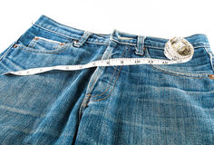 Tape measure and jean Stock Image