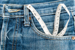 Tape measure and jean Stock Images
