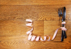 Tape measure with a knife and fork Royalty Free Stock Photo