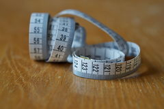 Tape measure measuring length in centimeters and meters, frequently used for measuring the perimeter of human body during the die Royalty Free Stock Image