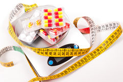Tape-measure and medicament Stock Photo