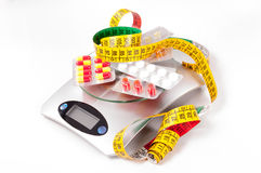 Tape-measure and medicament. About kitchen scale Stock Image