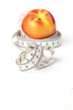 Tape measure and nectarine Stock Images