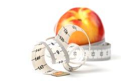 Tape measure and nectarine Stock Image