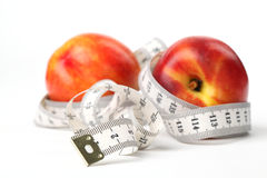 Tape measure and nectarines Royalty Free Stock Photography