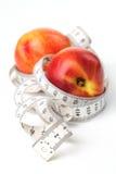 Tape measure and nectarines Stock Photo