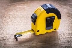 Tape measure on oaken wooden board maintenance Royalty Free Stock Photo