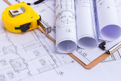 Tape measure over a construction plan drawing Stock Photos