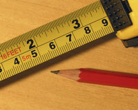 Tape measure and pencil Royalty Free Stock Photography