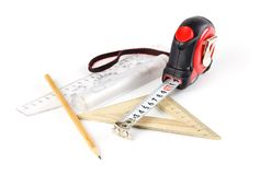 Tape measure, pencil and ruler on a white background. Closeup stock images