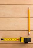 Tape measure and pencil on wood Stock Photos