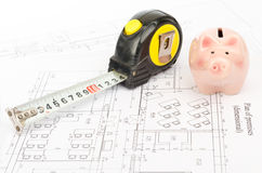 Tape measure with piggy bank, close up view Stock Photo