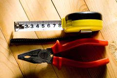 Tape measure and pliers Stock Photo