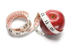 Tape Measure and Red Apple Stock Photos