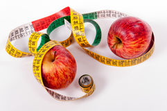 Tape measure and red apple Royalty Free Stock Photo
