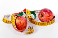 Tape measure and red apple Royalty Free Stock Photography