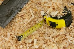 Tape measure and saw Stock Images