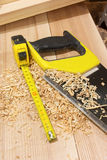 Tape-measure, and saw, desktop Royalty Free Stock Images