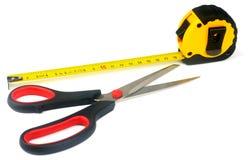 Tape-measure and scissors Stock Photo