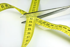 Tape measure and scissors Stock Photos