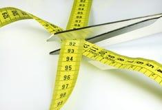 Tape measure and scissors Stock Photos