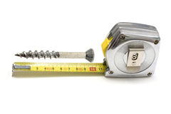 Tape measure and screw Royalty Free Stock Photos