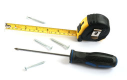 Tape measure screwdriver and screws Stock Photos