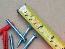 Tape measure and screws Stock Photo