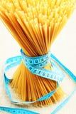 Tape measure and spaghetti Stock Image