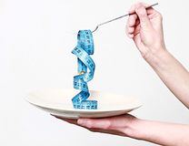 Tape measure spaghetti on the plate stock photo