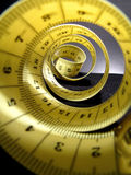 Tape measure spiral. On dark backgroun Royalty Free Stock Photography