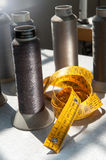 Tape measure and spools of yarn Royalty Free Stock Image